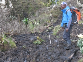 William Kiminywa finds a path through the mud.
