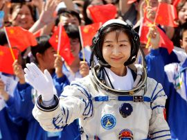 Liu Yang, China's first female astronaut, waves during a departure ceremony at Jiuquan Satellite Launch Center, Gansu province